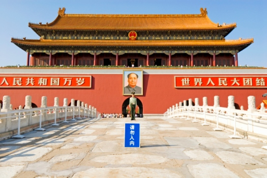 China, Beijing, Tiananmen Square, guard in front of chairmen Mao portrait